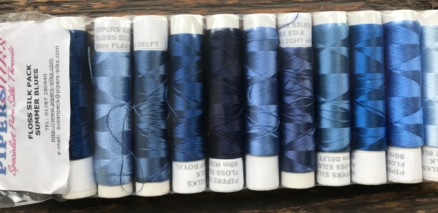 pack of reeled silk floss for embroidery in various shades of blue with label from Pipers Silks.